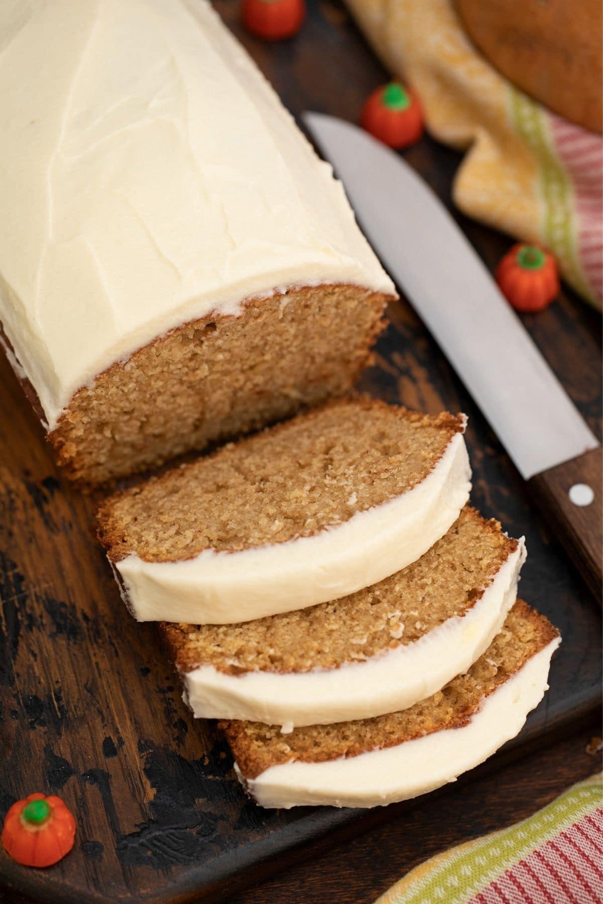 Sliced pumpkin bread on brown cutting board