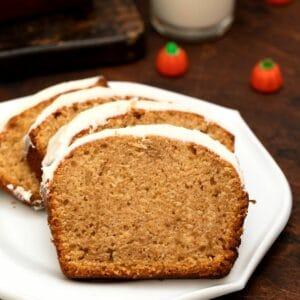 Sliced pumpkin bread on white plate