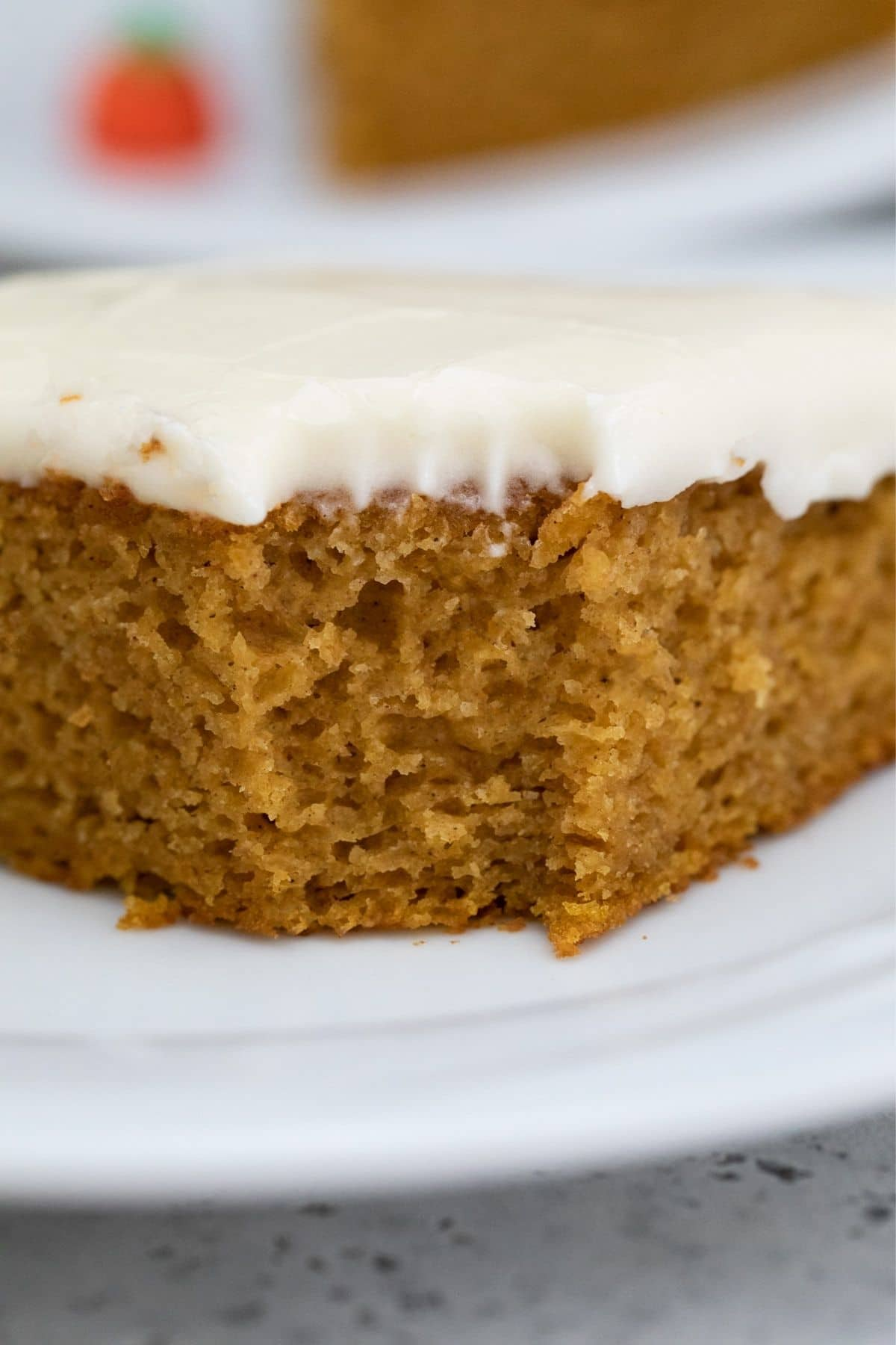 Close up of pumpkin sheet cake with bite out