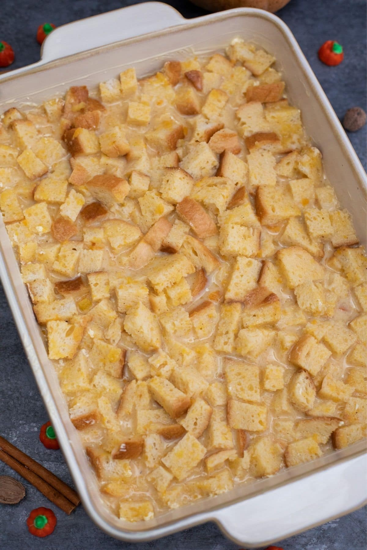 Bread in baking dish covered with custard
