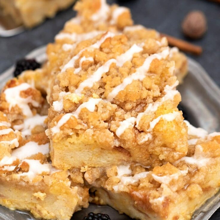 Squares of pumpkin spice french toast bake on black plate