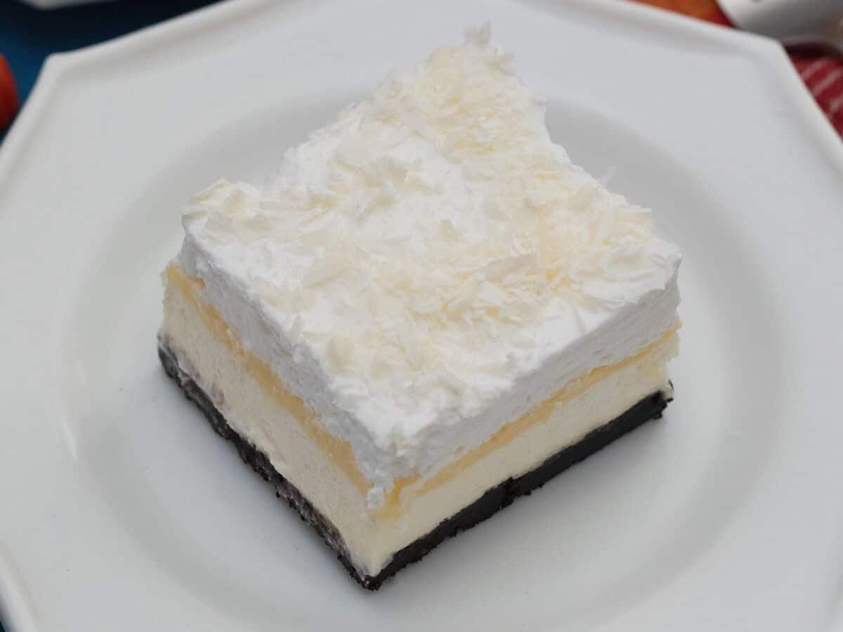 Small white saucer with layered pumpkin dessert slice