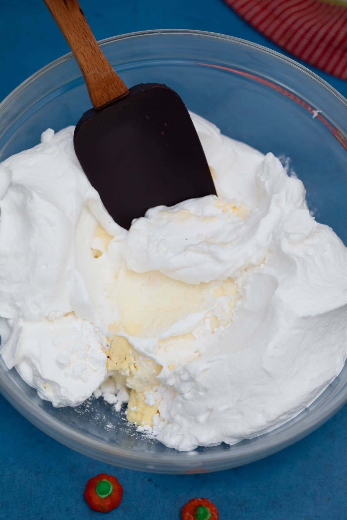 Glass bowl of cream cheese and whipped topping