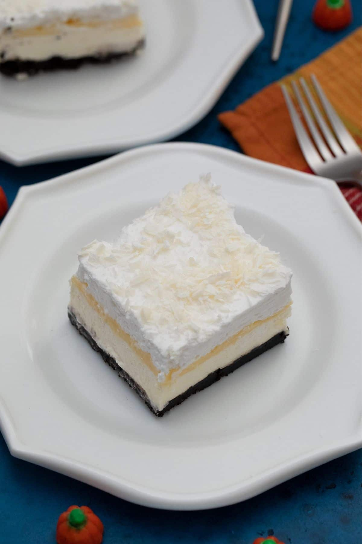 White plate with slice of pumpkin lasagna