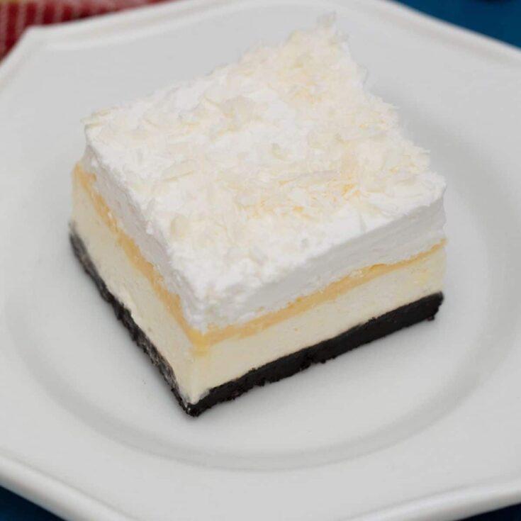 Slice of layered dessert on white plate