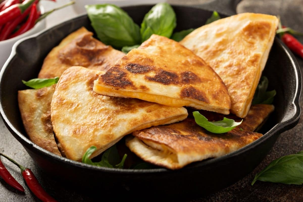 quesadillas in a cast iron pan