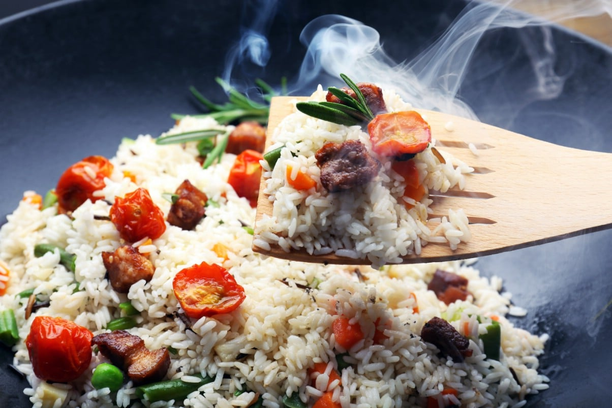 Delicious rice and vegetables meal freshly made in an electric wok.