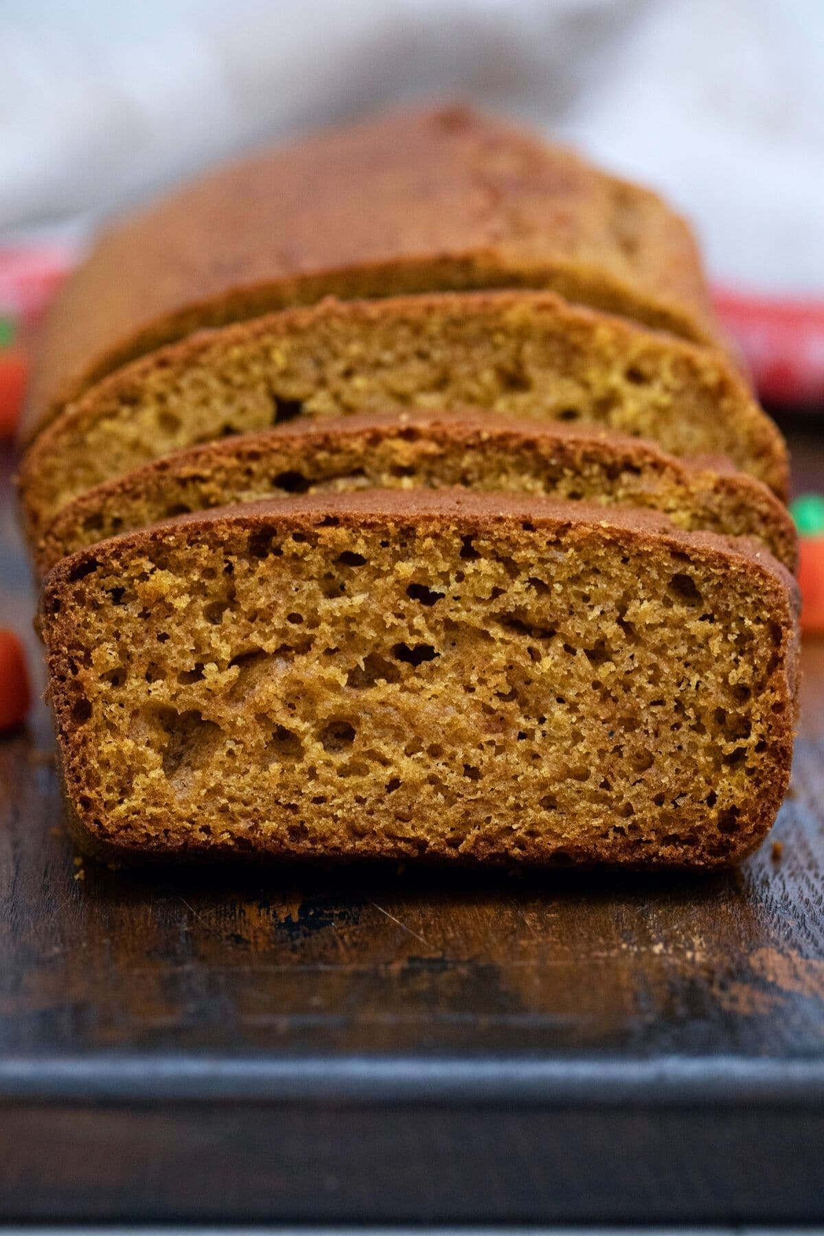 Front of pumpkin bread with slice showing inside of bread