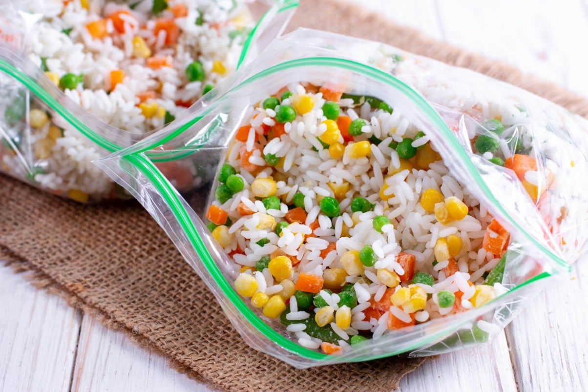 Rice with vegetables added into freezer bags.