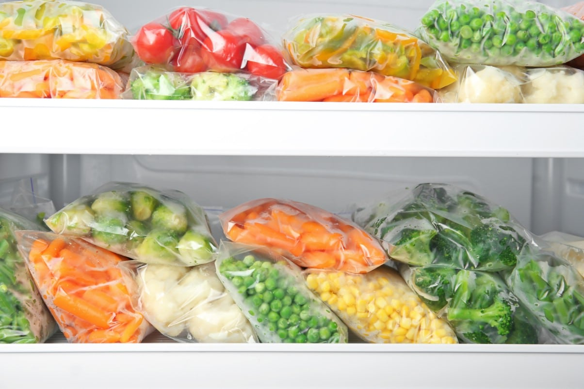 Fresh veggies and meals added to refridgerator.