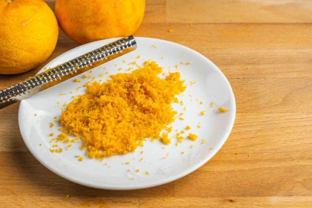 Fresh orange zest in a white plate.