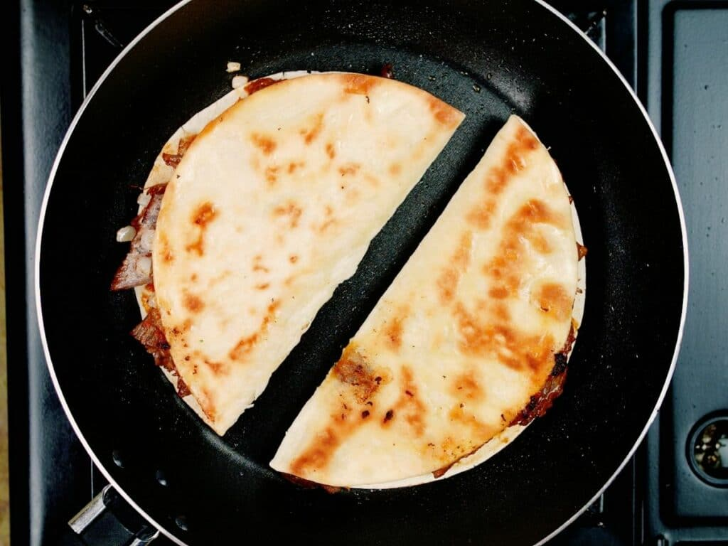 Two tacos in skillet