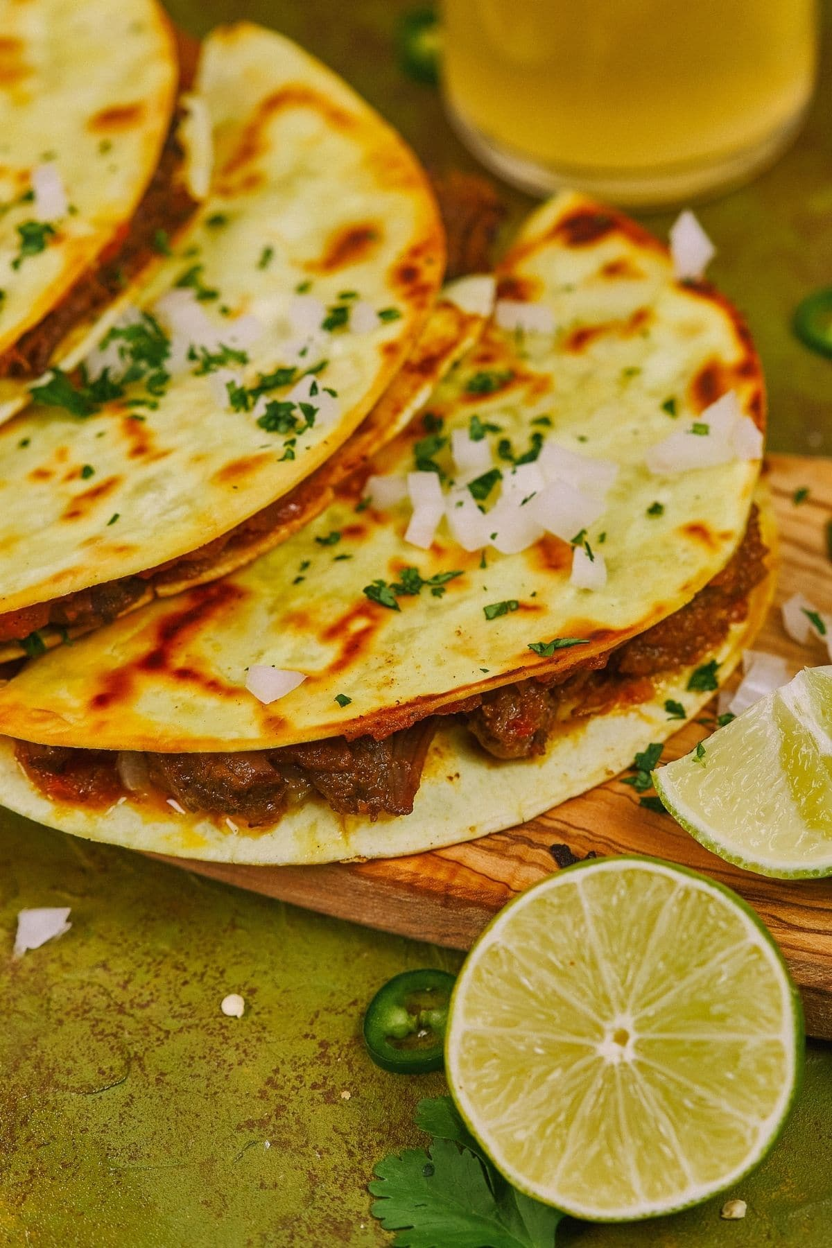 Lime wedge by stack of tacos