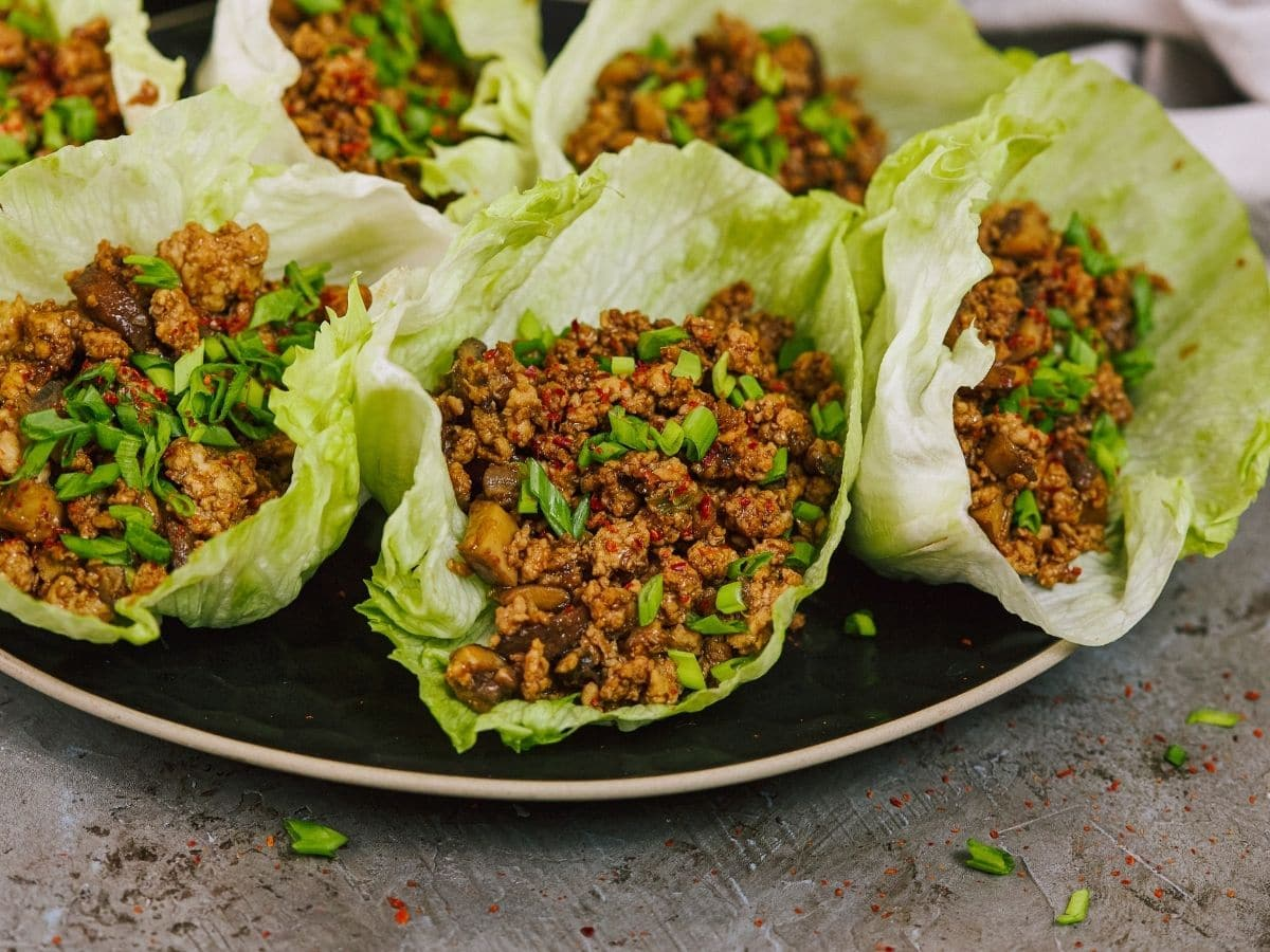 Large black plate of chicken lettuce wraps