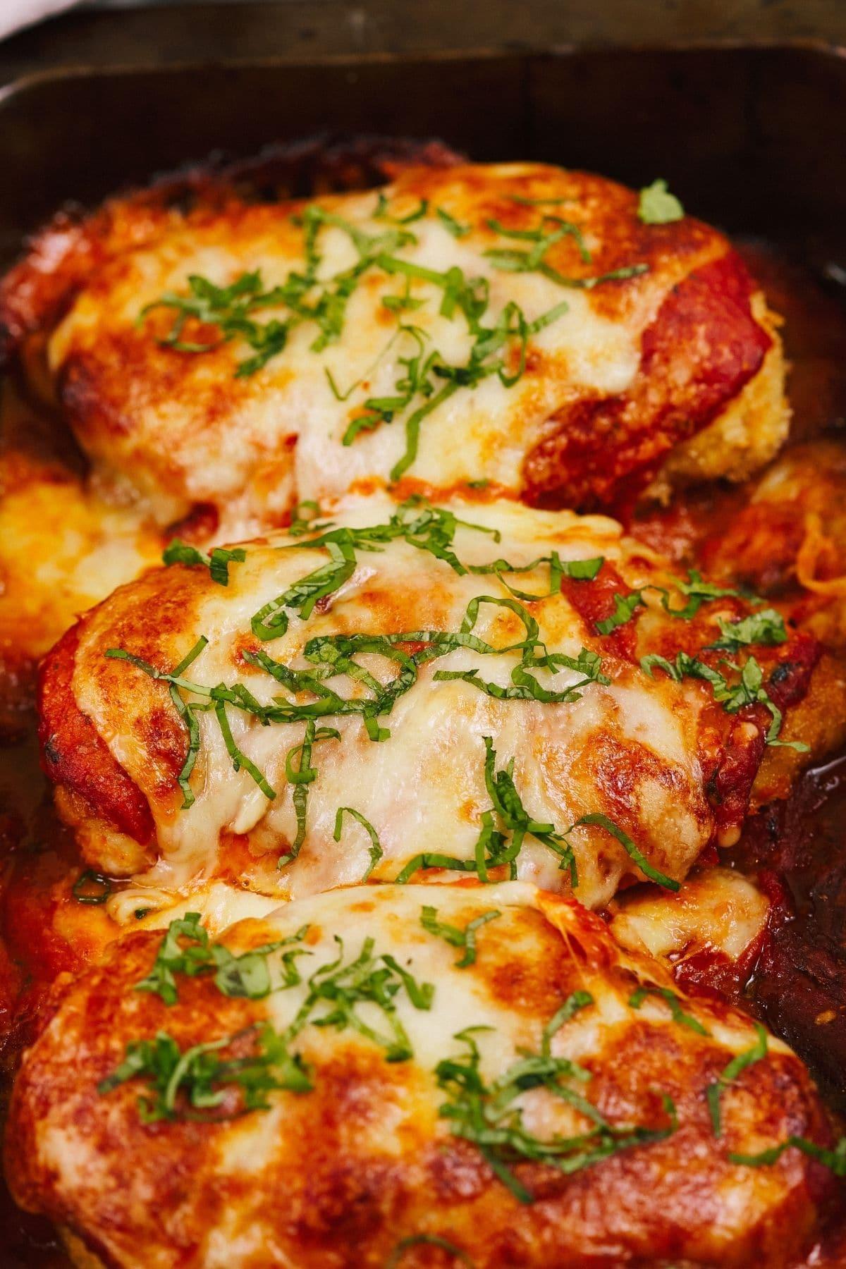 Chicken parmesan in black pan