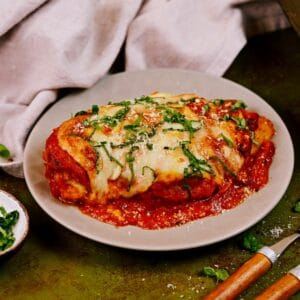 Chicken parmesan on gray plate on table