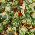 Close up picture of broccoli with cheese and bacon