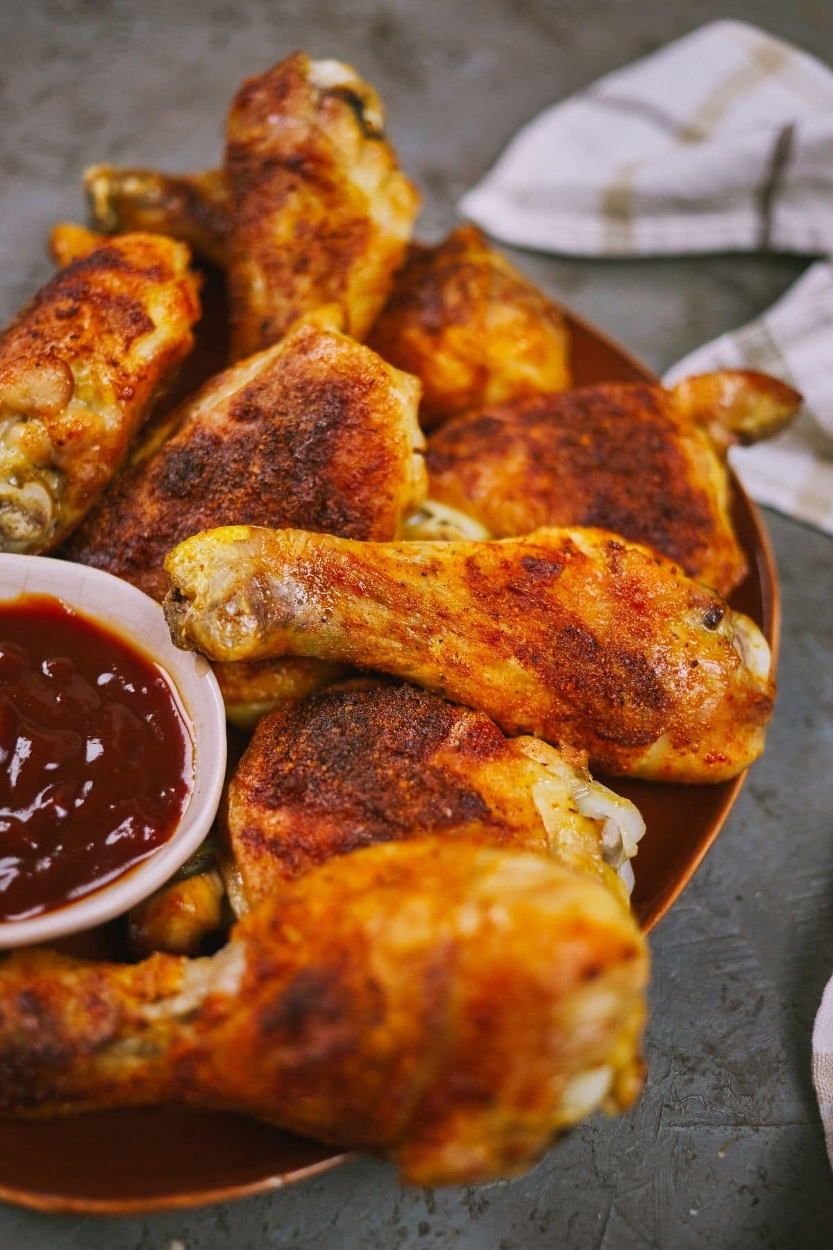 Cooked chicken on platter sitting on gray table