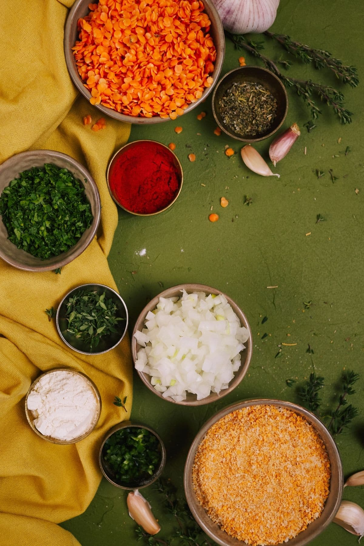 Ingredients in small bowls on green tablecloth