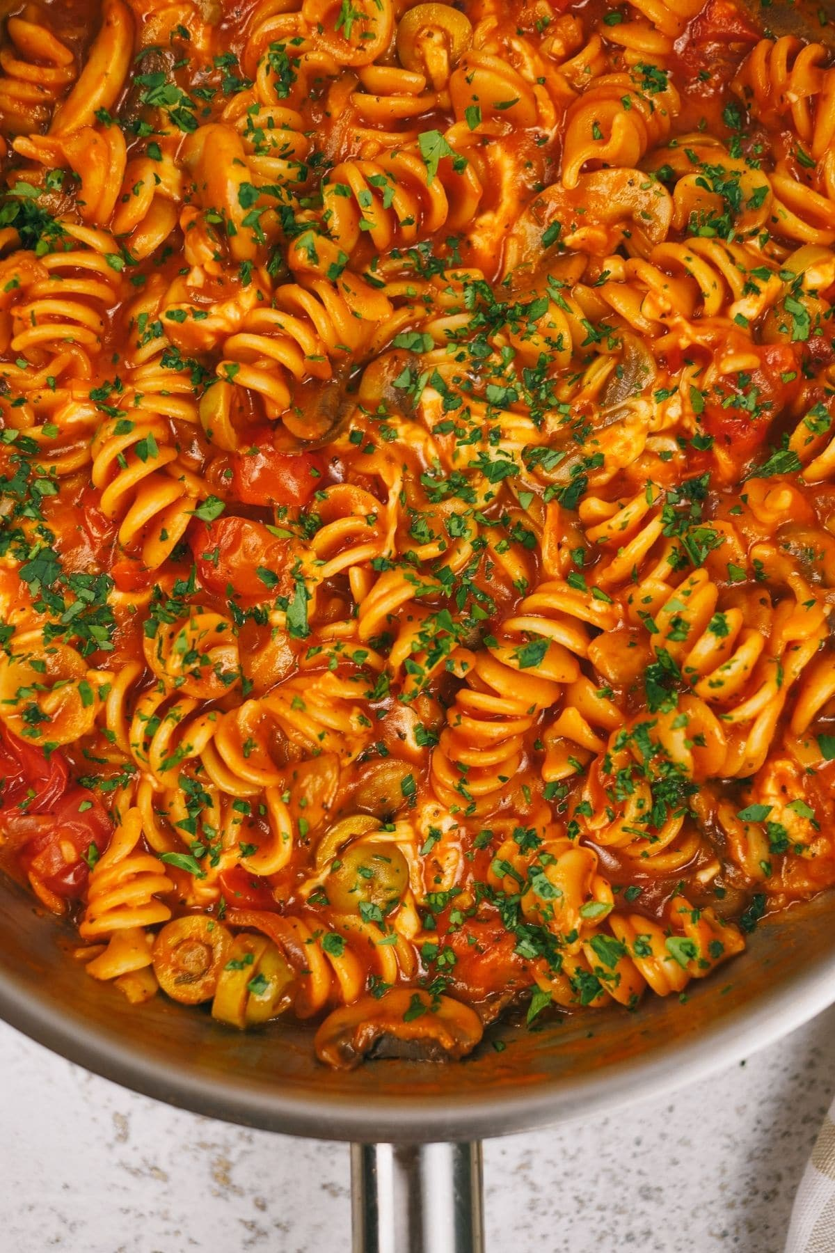 Skillet filled with pasta in tomato sauce