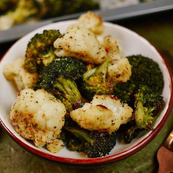 White bowl of broccoli and cauliflower