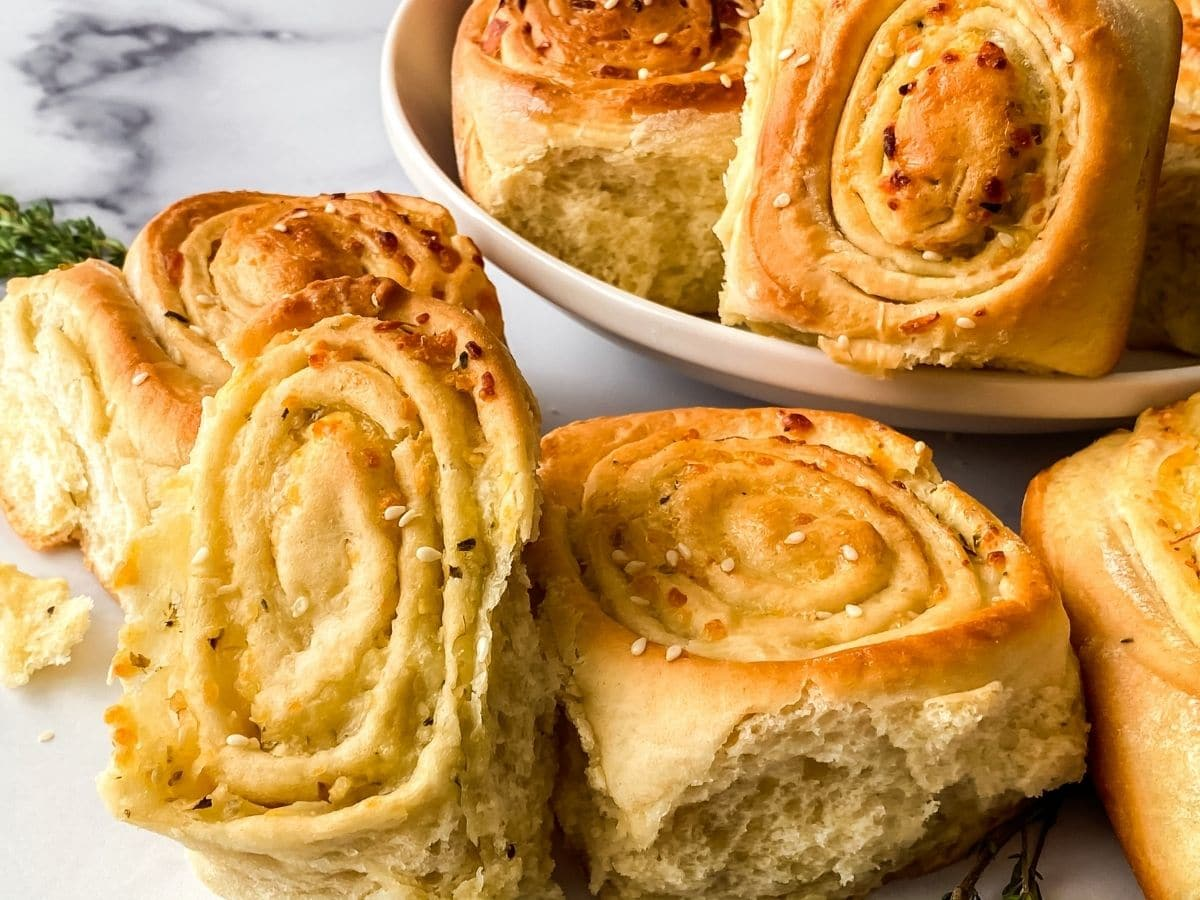 rolls leaning against white bowl