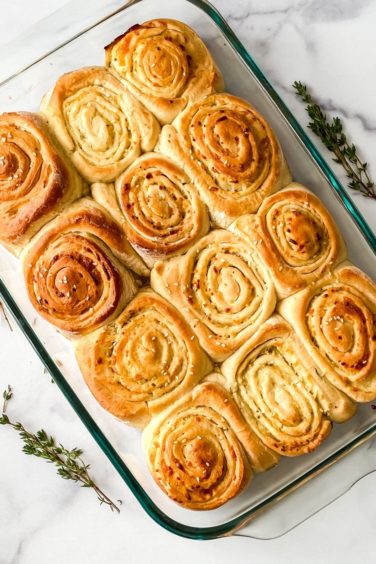 mozzarella and thyme rolls in baking dish