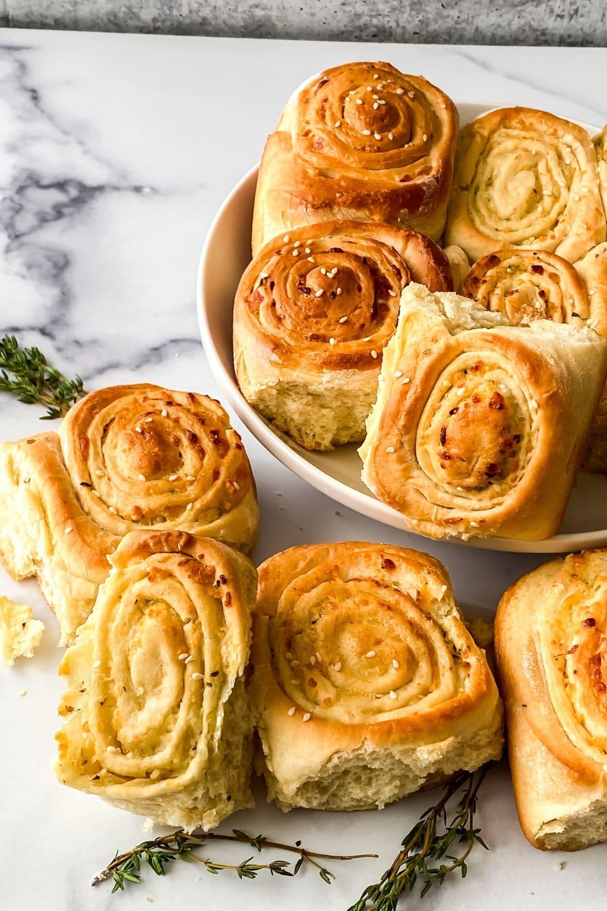 savory pinwheels baked sitting on marble counter