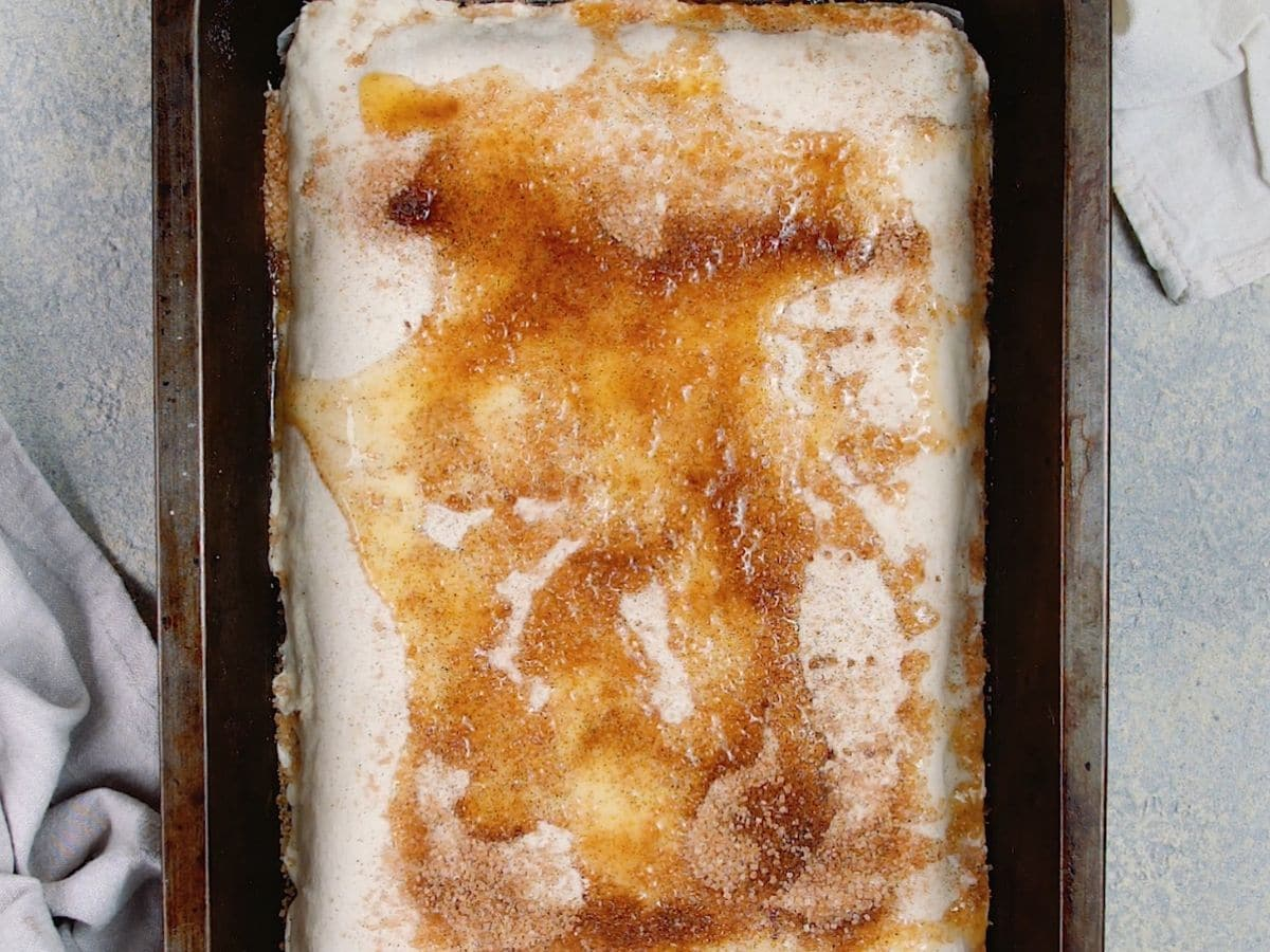 Cinnamon sugar and butter on top of puff pastry