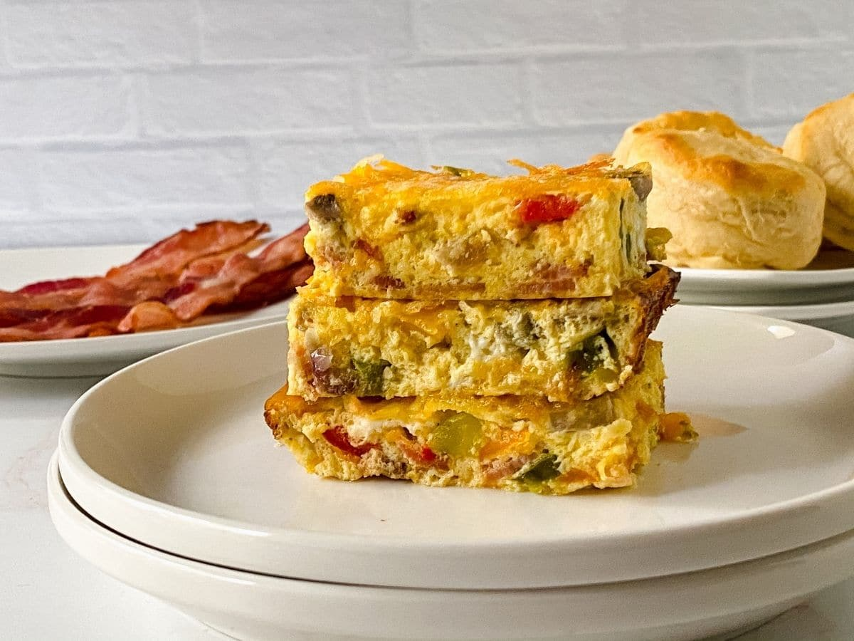 three slices of frittata on white saucer