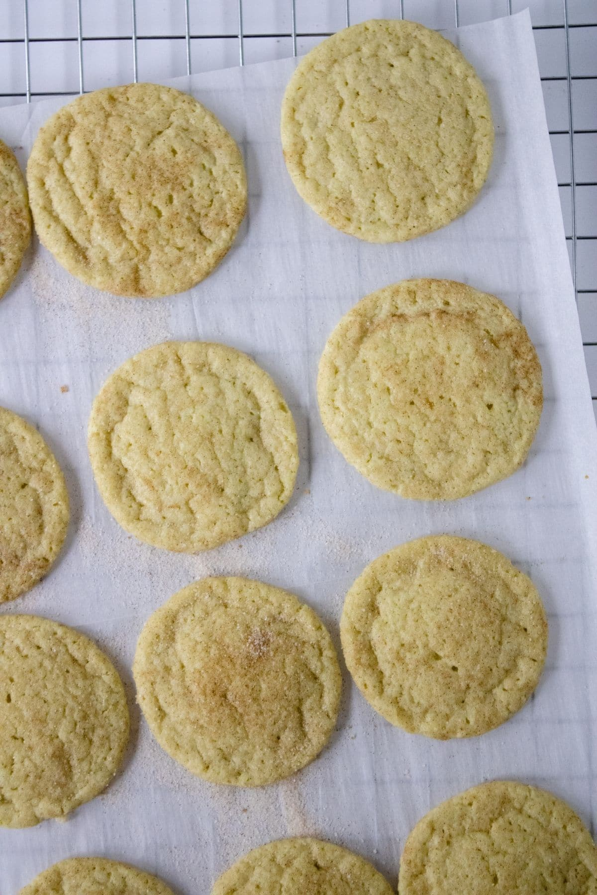 baked cookies on parchment paper on wire rack