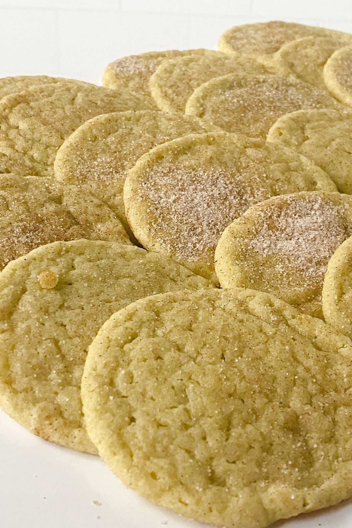 cookies topped with cinnamon sugar on table