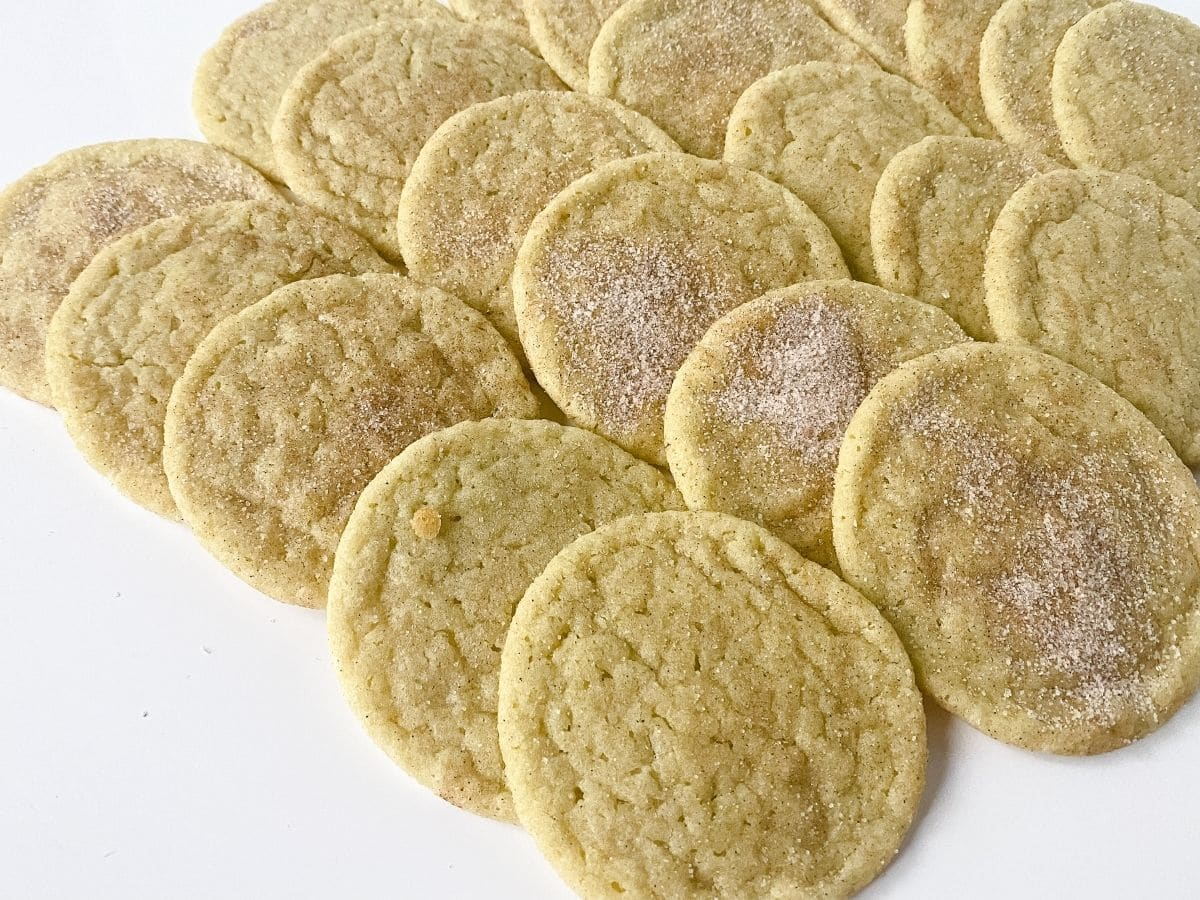 cookies topped with sugar laying on white table