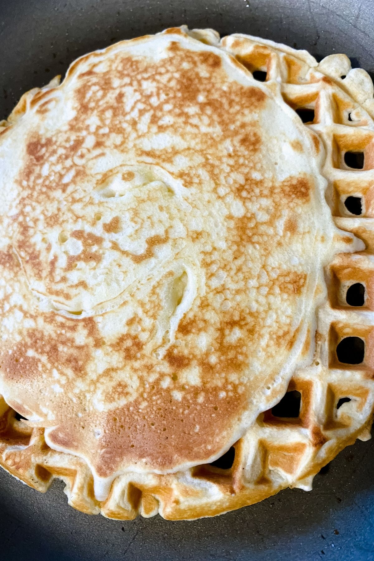 pancake on waffle in skillet